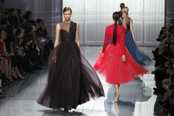 US model Karlie Kloss (L) presents a creation by British designer Bill Gaytten for Christian Dior during the Fall/Winter 2012-2013 ready-to-wear collection show, on March 2, 2012 in Paris.