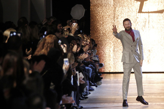 Italian designer Stefano Pilati for Yves Saint Laurent acknowledges the public following his Fall/Winter 2012-2013 ready-to-wear collection show