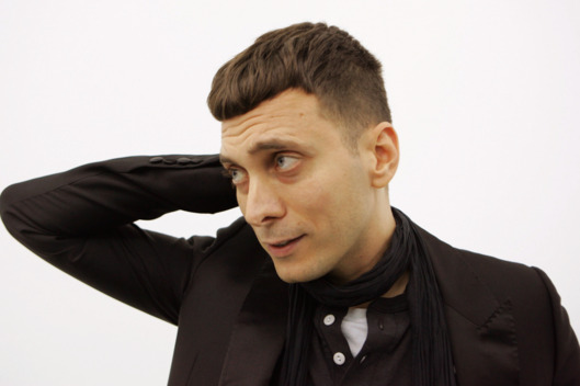 Artist and fashion designer Hedi Slimane talks to the media, during a group show