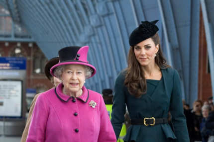 Queen Elizabeth II and Catherine, Duchess of Cambridge (R) arrive at St Pancras station