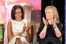 US First Lady Michelle Obama (R) and Secretary of State Hillary Clinton attend the 2012 International Women of Courage Awards ceremony at the State Department in Washington, DC, on March 8, 2012.