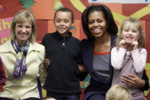 First lady Michelle Obama poses for a photo with New Hampshire's first lady, Dr. Susan Lynch and  pre-schoolrs at the Penacook Community Center