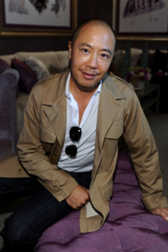 Designer Derek Lam poses during Mercedes-Benz Fashion Week Spring 2012