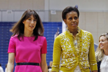 First lady Michelle Obama (L) and Samantha Cameron, wife of British Prime Minister David Cameron, participate in an Olympics-themed event with area school children