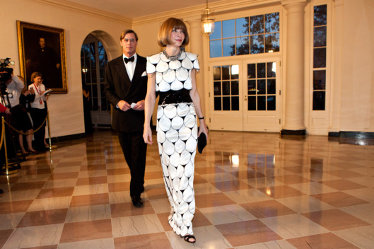 Anna Wintour, editor-in-chief of Vogue magazine (R), arrives with Shelby Bryan for a State Dinner in honor of British Prime Minister David Cameron at the White House on March 14, 2012 in Washington, DC. Cameron is on a three day official visit to Washington.