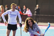 Women's Team GB hockey captain Kate Walsh watches Catherine, Duchess of Cambridge play hockey with the GB hockey teams at the Riverside Arena in the Olympic Park
