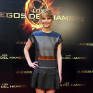 Actress  Jennifer Lawrence of &quot;The Hunger Games&quot; (Los Juegos del Hambre) attends an event with fans at Capitol cinema on March 26, 2012 in Madrid, Spain.
