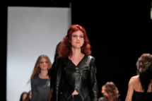 Russian Anna Chapman, center, who was deported from the U.S. on charges of espionage, displays a creations by I Love Fashion, France, during Fall-Winter 2012 - 2013 collection at Mercedes-Benz Fashion Week in Moscow,  Russia, Thursday, March 22, 2012.