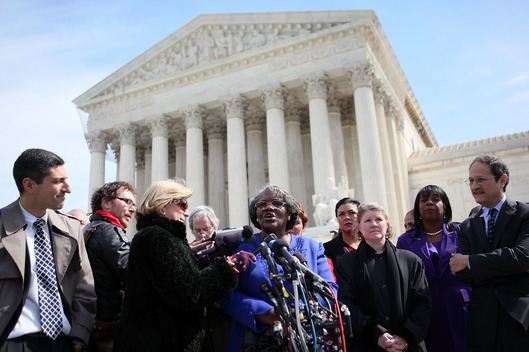 Betty Dukes (C), one of the six named plaintiffs in the Dukes v Wal-Mart case, speaks to the media in front of the U.S. Supreme Court as lead counsel Brad Seligman (R) looks on March 29, 2011 in Washington, DC.
