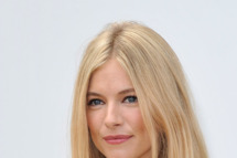 Sienna Miller attends the Burberry Spring Summer 2012 Womenswear Show at Kensington Gardens on September 19, 2011 in London, England.