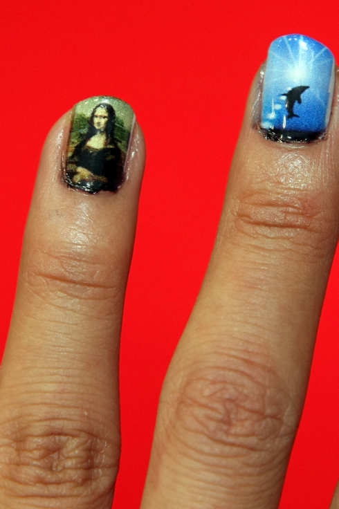 "A model shows nail art decorated with ""e-nail"", nail art machine which scans and prints their favourite images on their nails during the Diet And Beauty Fair 2008 at Tokyo Big Sight on August 25, 2008 in Tokyo, Japan."