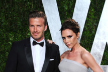 Athlete David Beckham (L) and entertainer Victoria Beckham