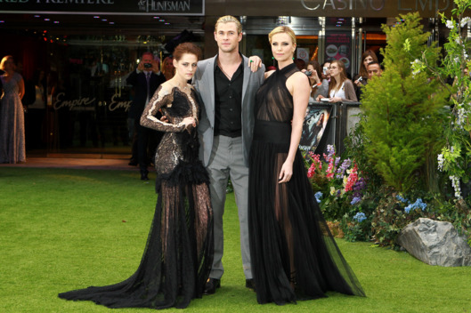 LONDON, UNITED KINGDOM - MAY 14: Kristen Stewart, Chris Hemsworth and Charlize Theron attends premiere of 'Snow White And The Huntsman'