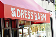 Pedestrians pass by a Dress Barn store in New York, U.S. on Wednesday, Sept. 19, 2007. Dress Barn Inc., the women's clothing retailer with 1,428 stores, rose as much as 8.3 percent in U.S. trading after reporting fourth-quarter profit that exceeded analysts' estimates. Photographer: Stephen Hilger/Bloomberg News