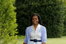 First lady Michelle Obama arrives for an interview with The Associated Press to talk about the White House Kitchen Garden, Tuesday, June 5, 2012, on the South Lawn of the White House in Washington. (AP Photo/Charles Dharapak)