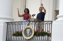 U.S. President Barack Obama, with first lady Michelle Obama delivers remarks to an Independence Day picinic on the South Lawn of the White House on July 4, 2012 in Washington, D.C.