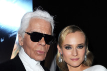 Designer Karl Lagerfeld and actress Diane Kruger attend the 2012 amfAR's Cinema Against AIDS during the 65th Annual Cannes Film Festival at Hotel Du Cap on May 24, 2012 in Cap D'Antibes, France.
