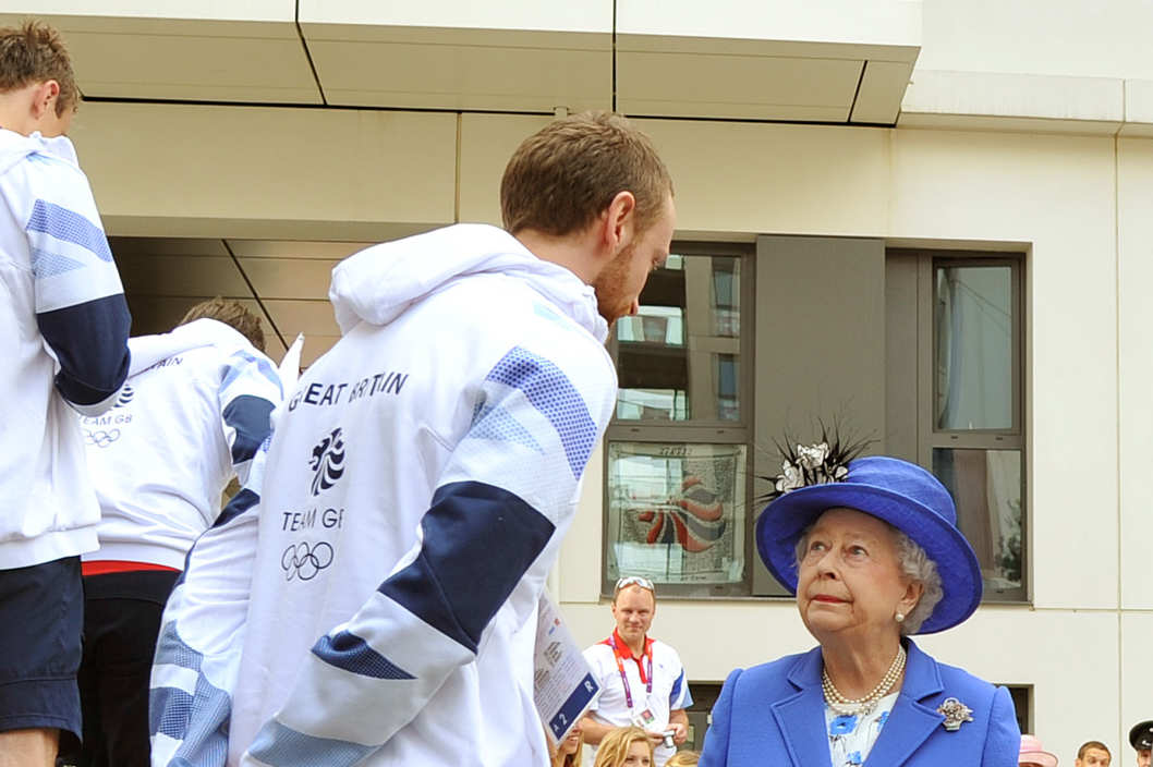 Queen Elizabeth Il  meets one of the taller members of the Great Britain team during a tour of the Athletes Village on day one of the London 2012 Olympics Games on July 28, 2012 in London, England.