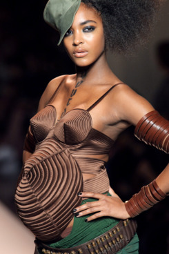 Pregnant Jourdan Dunn presents an outfit by French designer Jean Paul Gaultier during ready-to-wear Spring-Summer 2010 fashion show in on October 3, 2009 in Paris.