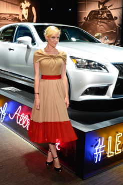 "Jaime King poses in front of the Lexus display vehicle at the Lexus ""Laws of Attraction"" at Metreon on July 30, 2012 in San Francisco, California."