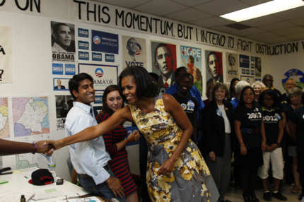 First lady Michelle Obama greets volunteers during a visit to a campaign field office during a visit in Raleigh, N.C., Wednesday, Aug. 1, 2012.