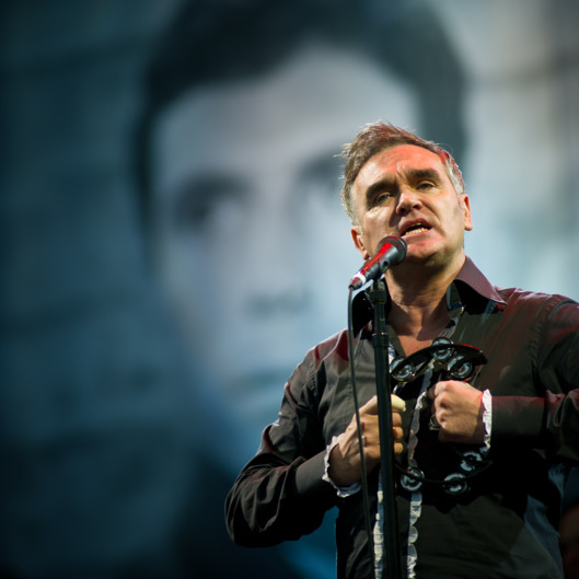 GLASTONBURY, ENGLAND - JUNE 24: Morrissey performs live on the pyramid stage during the Glastonbury Festival at Worthy Farm, Pilton on June 24, 2011 in Glastonbury, England. The festival, which started in 1970 has grown into Europe's largest music festival attracting more than 175,000 people over five days  (Photo by Ian Gavan/Getty Images)