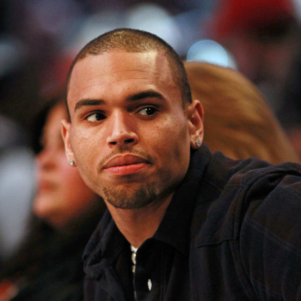 ORLANDO, FL - FEBRUARY 26:  Recording artist Chris Brown sits courtside during the 2012 NBA All-Star Game at the Amway Center on February 26, 2012 in Orlando, Florida.  NOTE TO USER: User expressly acknowledges and agrees that, by downloading and or using this photograph, User is consenting to the terms and conditions of the Getty Images License Agreement.  (Photo by Ronald Martinez/Getty Images)