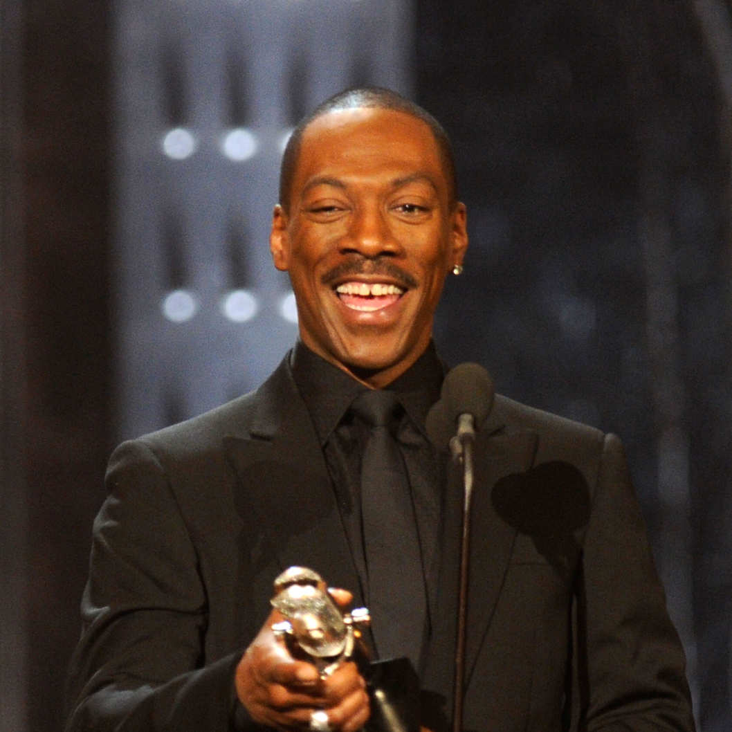 NEW YORK, NY - MARCH 26:  Comedian Eddie Murphy speaks onstage at The First Annual Comedy Awards at Hammerstein Ballroom on March 26, 2011 in New York City.  (Photo by Dimitrios Kambouris/Getty Images) *** Local Caption *** Eddie Murphy