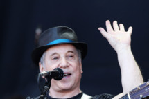 GLASTONBURY, ENGLAND - JUNE 26:  (UK TABLOID NEWSPAPERS OUT) Paul Simon performs on the Pyramid Stage at the Glastonbury Festival at Worthy Farm, Pilton on June 26, 2011 in Glastonbury, England. The festival, which started in 1970 when several hundred hippies paid 1 GBP to watch Marc Bolan, has grown into Europe's largest music festival attracting more than 175,000 people over five days.  (Photo by Dave Hogan/Getty Images)