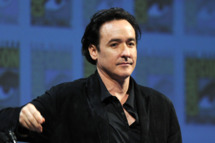 "SAN DIEGO, CA - JULY 22:  Actor John Cusack speaks at ""The Raven"" Panel during Comic-Con 2011 on July 22, 2011 in San Diego, California.  (Photo by Kevin Winter/Getty Images)"