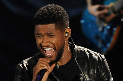 Usher performs at the Clinton Foundation's Decade of Difference concert on October 15, 2011 at the Hollywood Bowl in Hollywood, California. The concert celebrates 10 years of the former US president's Clinton Foundation.   RESTRICTED TO EDITORIAL USE    AFP PHOTO / ROBYN BECK (Photo credit should read ROBYN BECK/AFP/Getty Images)
