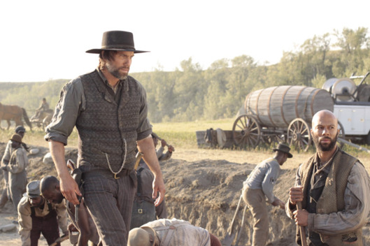 Cullen Bohannon (Anson Mount) and Elam Jefferson (Common) - Hell On Wheels - Season 1, Episode 1 - Photo Credit: Chris Large/AMC - HOW_101_2425