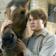 """WAR HORSE""  DM-AC-00047  Albert (Jeremy Irvine) and his horse Joey are featured in this scene from DreamWorks Pictures' ""War Horse"", director Steven Spielberg's epic adventure for audiences of all ages, set against a sweeping canvas of rural England and Europe during the First World War.  Ph: Andrew Cooper, SMPSP  ©DreamWorks II Distribution Co., LLC.  All Rights Reserved."