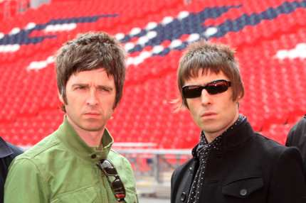 LONDON - OCTOBER 16:  (UK TABLOID NEWSPAPERS OUT) L-R Noel Gallagher and Liam Galllagher attend the Oasis photocall in Wembley Stadium to promote their new album 'Dig out Your Soul' released on October 6, and their two sold out concerts at Wembley Arena, on October 16, 2008 in London, England.  (Photo by Dave Hogan/Getty Images)