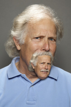 Man with grey hair looking skeptical