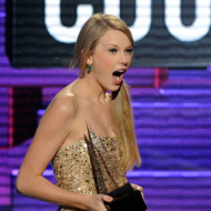 LOS ANGELES, CA - NOVEMBER 20:  Singer Taylor Swift accepts Favorite Country Female Artist award onstage at the 2011 American Music Awards held at Nokia Theatre L.A. LIVE on November 20, 2011 in Los Angeles, California.  (Photo by Kevork Djansezian/Getty Images)