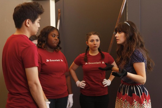 "NEW GIRL:  Jess (Zooey Deschanel, R) prepares the members of her handbell quartet (L-R: guest stars Ki Hong Lee, Raven Goodwin and Esther Povitsky) to perform in the ""Bells"" episode of NEW GIRL airing Tuesday, Nov. 29 (9:00-9:30 PM ET/PT) on FOX. ©2011 Fox Broadcasting Co. Cr:  Greg Gayne/FOX"