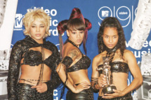 "NEW YORK, UNITED STATES:  The all-female group TLC won the MTV Video Music Award for Best Group Video for their video ""No Scrubs"" during the ceremony at the Metropolitan Opera House at the Lincoln Center in New York 09 September, 1999.  AFP PHOTO   Henny Ray ABRAMS (Photo credit should read HENNY RAY ABRAMS/AFP/Getty Images)"