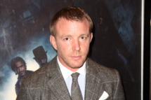 LONDON, ENGLAND - DECEMBER 08:  (UK TABLOID NEWSPAPERS OUT) Guy Ritchie attends the European premiere of Sherlock Holmes: A Game Of Shadows at The Empire Leicester Square on December 8, 2011 in London, United Kingdom.  (Photo by Dave Hogan/Getty Images)