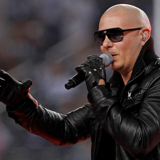 ARLINGTON, TX - NOVEMBER 24:  Singer Pitbull performs at halftime during the Thanksgiving Day game between the Miami Dolphins and the Dallas Cowboys at Cowboys Stadium on November 24, 2011 in Arlington, Texas.  (Photo by Ronald Martinez/Getty Images)