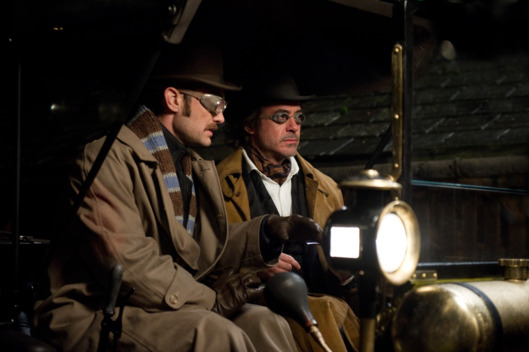 "(L-r) JUDE LAW as Dr. James Watson and ROBERT DOWNEY JR. as Sherlock Holmes in Warner Bros. Pictures' and Village Roadshow Pictures' action adventure mystery ""SHERLOCK HOLMES: A GAME OF SHADOWS,"" a Warner Bros. Pictures release."
