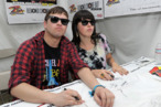 INDIO, CA - APRIL 16:  Musicians Derek E. Miller and Alexis Krauss of Sleigh Bells sign autographs during Day 2 of the Coachella Valley Music & Arts Festival 2011 held at the Empire Polo Club on April 16, 2011 in Indio, California.  (Photo by Charley Gallay/Getty Images) *** Local Caption *** Derek E. Miller;Alexis Krauss