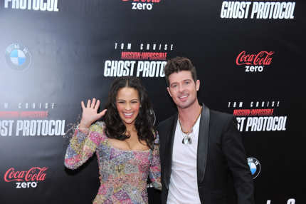 "NEW YORK, NY - DECEMBER 19:  Paula Patton and Robin Thicke attend the ""Mission: Impossible - Ghost Protocol"" U.S. premiere at the Ziegfeld Theatre on December 19, 2011 in New York City.  (Photo by Stephen Lovekin/Getty Images)"