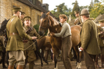 """WAR HORSE""  DM AC 33426R  Captain Nicholls (Tom Hiddleston, far left) and Sergeant Perkins (Geoff Bell) prepare to take Joey away with them. Albert (Jeremy Irvine, center) holds on to Joey defiantly while his father (Peter Mullan, right) looks on in this scene from DreamWorks Pictures' ""War Horse"". Director Steven Spielberg's epic adventure is set against a sweeping canvas of rural England and Europe during the First World War.  Ph: Andrew Cooper, SMPSP  ?DreamWorks II Distribution Co., LLC. ?All Rights Reserved."