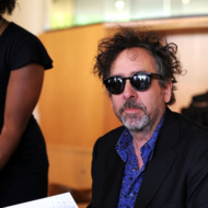 "LOS ANGELES, CA - MAY 28:  Director Tim Burton signs copies of his Exhibition Catalogue And The ""Art Of Tim Burton""  at LACMA where his work is currently being exhibited on May 28, 2011 in Los Angeles, California.  (Photo by Frazer Harrison/Getty Images)"