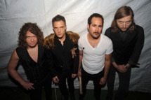 CHICAGO - AUGUST 09: (L-R) Dave Keuning, Brandon Flowers, Ronnie Vannucci Jr. and Mark Stoermer of The Killers pose backstage before performing during the 2009 Lollapalooza music festival at Grant Park on August 9, 2009 in Chicago, Illinois. (Photo by Jeff Gentner/Getty Images)