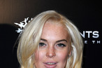 """LOS ANGELES, CA - OCTOBER 12:  Actress Lindsay Lohan attends the Premiere Of THQ's """"Saints Row: The Third"""" on October 12, 2011 in Los Angeles, California.  (Photo by Valerie Macon/Getty Images)"""