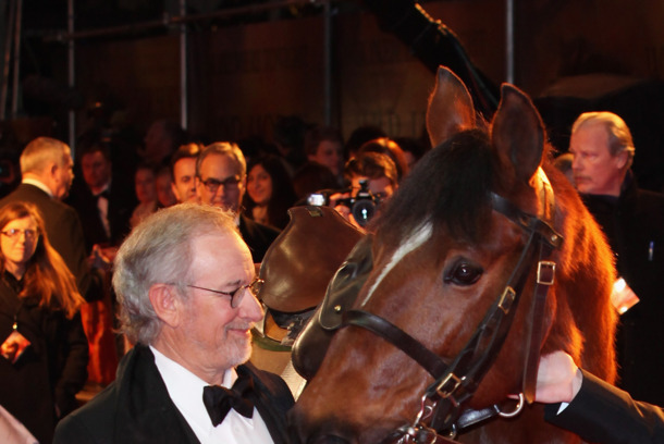 LONDON, ENGLAND - JANUARY 08:  Director Steven Spielberg poses with Joey, the War Horse during the UK premiere of War Horse at Odeon Leicester Square on January 8, 2012 in London, England.  (Photo by Tim Whitby/Getty Images)