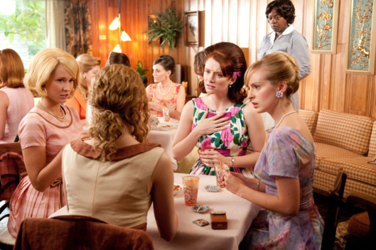 """THE HELP""TH-026RSkeeter Phelan (Emma Stone, back to camera) makes a remark that shocks her bridge-playing friends Elizabeth Leefolt (Ahna O'Reilly, seated right), (right to left) Hilly Holbrook (Bryce Dallas Howard) and Jolene French (Anna Camp), while Aibileen Clark (Academy Award? nominee Viola Davis, far right) looks on, in DreamWorks Pictures' inspiring drama, ""The Help,"" based on the New York Times best-selling novel by Kathryn Stockett. ""The Help"" is written for the screen and directed by Tate Taylor, with Brunson Green, Chris Columbus and Michael Barnathan producing.Ph: Dale Robinette?DreamWorks II Distribution Co., LLC. ?All Rights Reserved."
