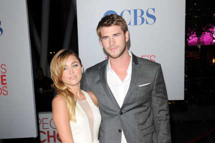 Singer Miley Cyrus and actor Liam Hemsworth arrive at the 2012 People's Choice Awards held at Nokia Theatre L.A. Live on January 11, 2012 in Los Angeles, California.